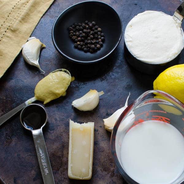 buttermilk, parmesan, garlic, lemon, dijon, black peppercorns, mayonnaise, lemon