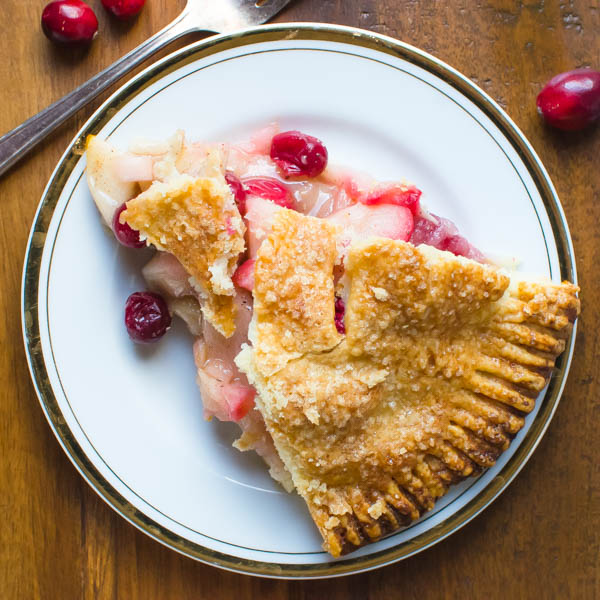 a slice of Sweet-Tart Apple Cranberry Pie