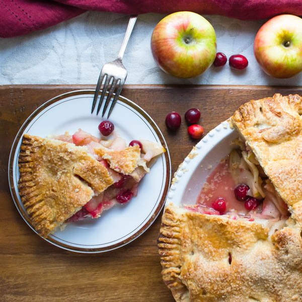 Sweet-Tart Apple Cranberry Pie on a board.