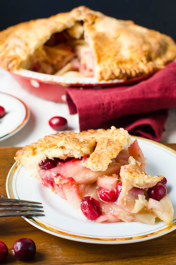 Sweet-Tart Apple Cranberry Pie on a plate.