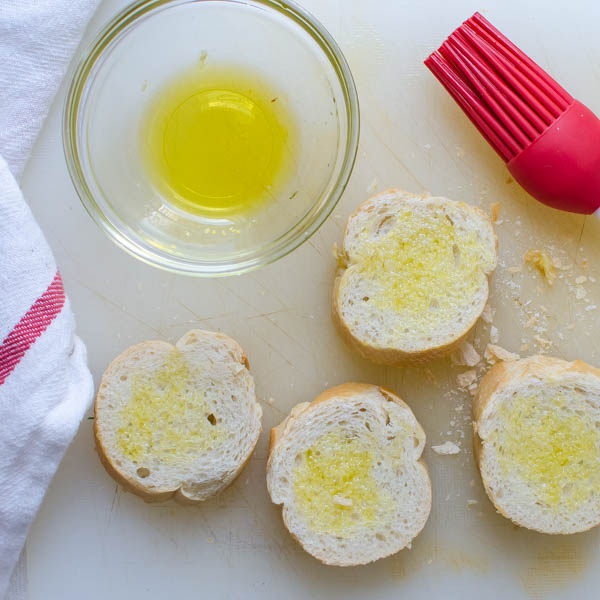 brushing baguettes with olive oil