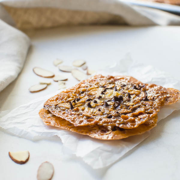 Chocolate Almond Florentines on parchment.