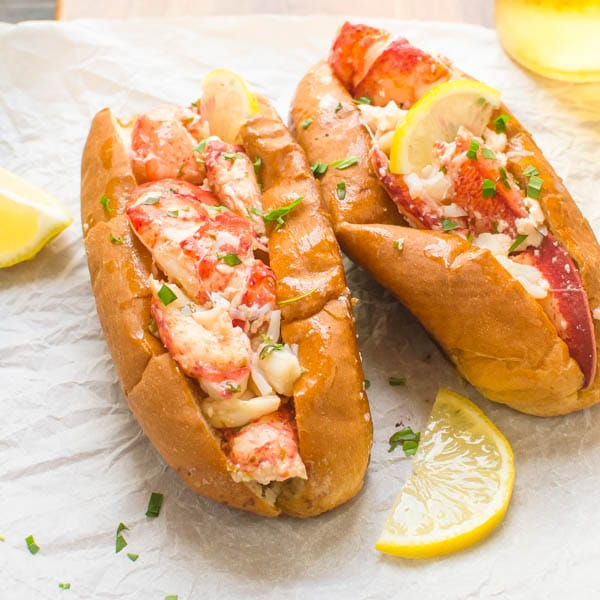 Warm Lemon Butter Lobster Roll with lemon slices