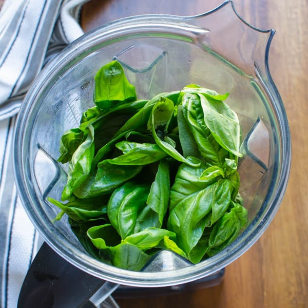 8 cups of basil leaves in a blender.
