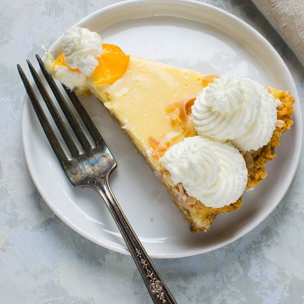 slice of calamondin pie on a plate with fork.