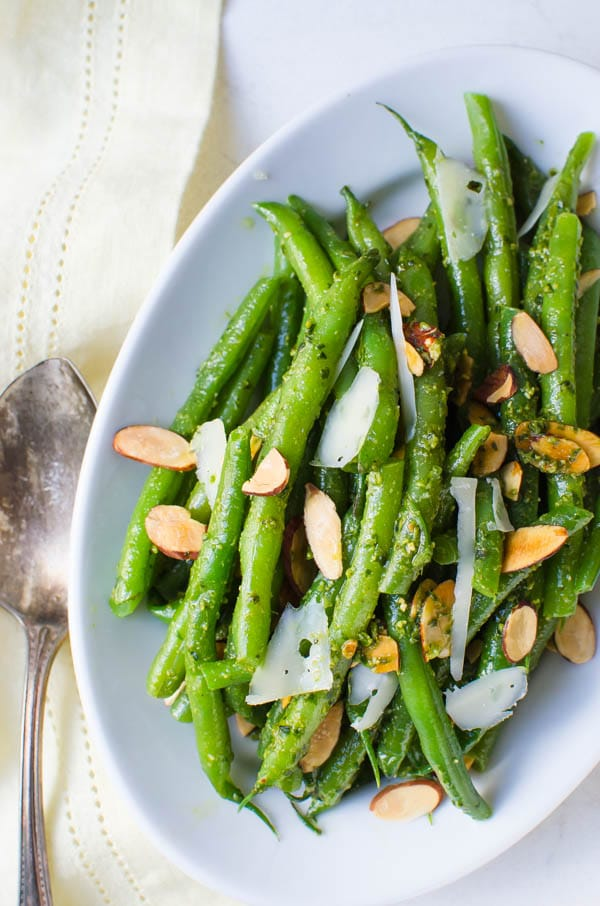 Spring Pesto Green Beans with a serving spoon.