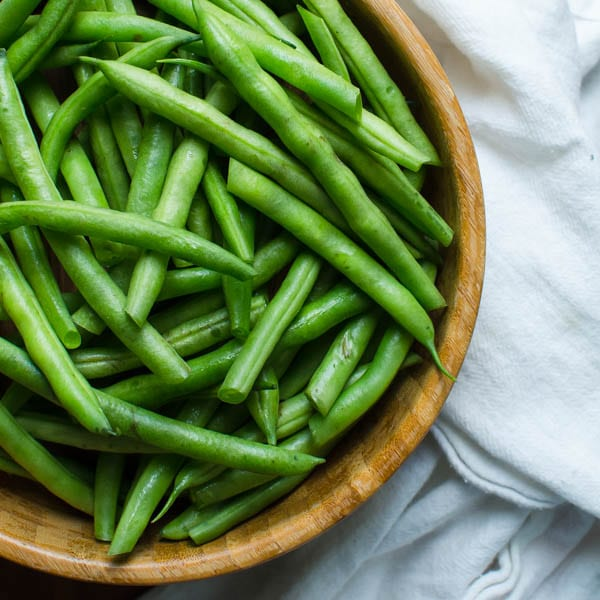 bowl of raw green beans.