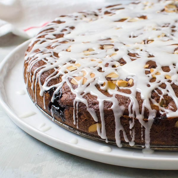 Glazed Cherry Almond Coffeecake on a cake plate.