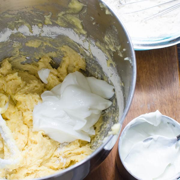 adding yogurt to the cake batter.