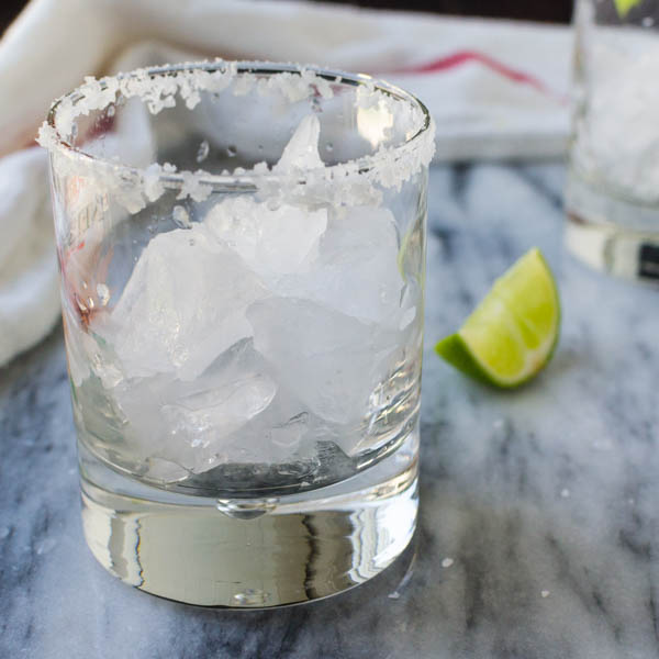 cocktail glass filled with crushed ice and a salt rim.