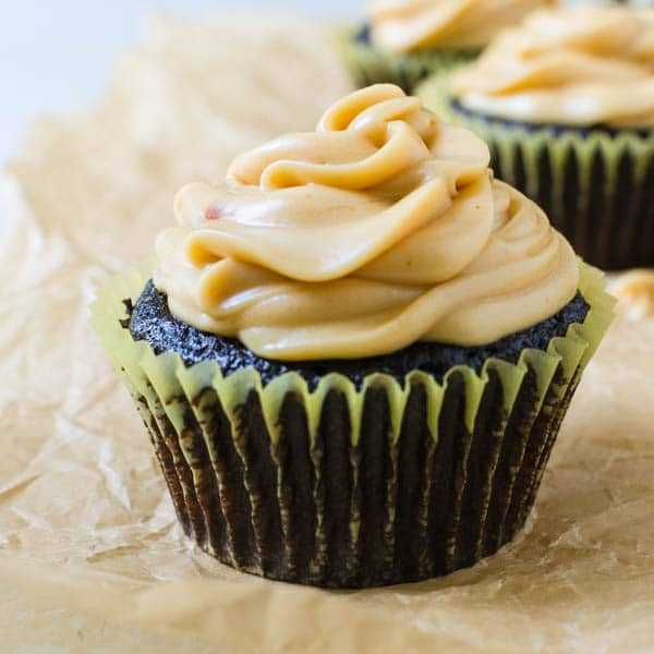 turtle cupcakes with caramel cream cheese frosting.