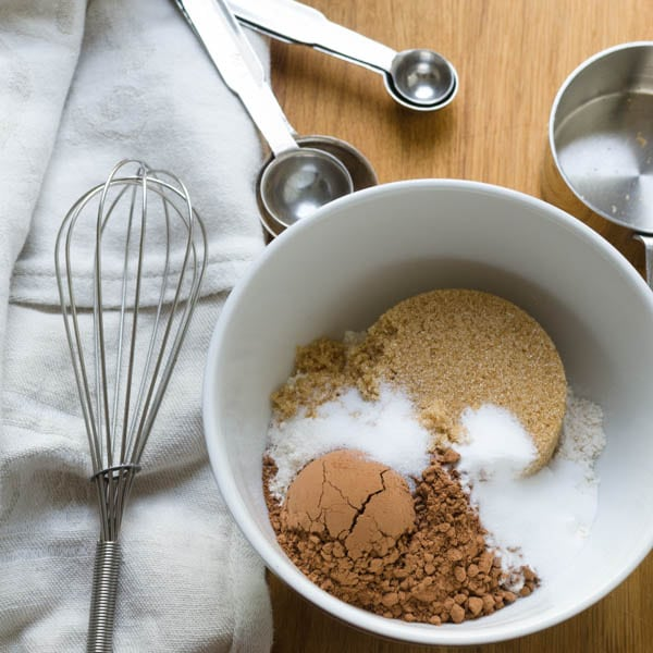 dry ingredients for cupcakes in a small bowl with a whisk.
