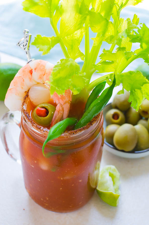 garnishing the vodka tomato juice cocktail with bloody mary skewers