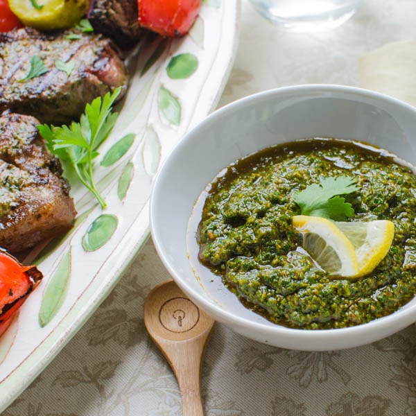 chermoula sauce next to Grilled Chermoula Marinated Strip Steaks.