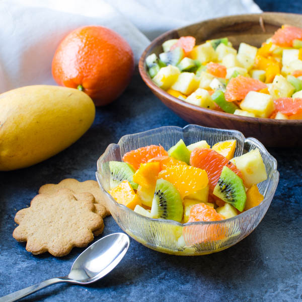 Rum Spiked Tropical Fruit Salad with cookies.
