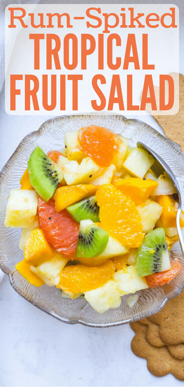 If you live in the tropics, you know the abundance of yield that comes from tropical fruit trees and why you need a tropical fruit salad recipe in your back pocket for when the fruit is ready. This healthy fruit salad gets a hearty dose of dark rum for a rum-spiked tropical fruit salad you'll love. #fruitsalad #tropicalfruit #pineapple #oranges #kiwi #mango #rum #darkrum #healthyfruitsalad #fruitsaladwithrum #papaya #guava #citrus #dragonfruit #starfruit