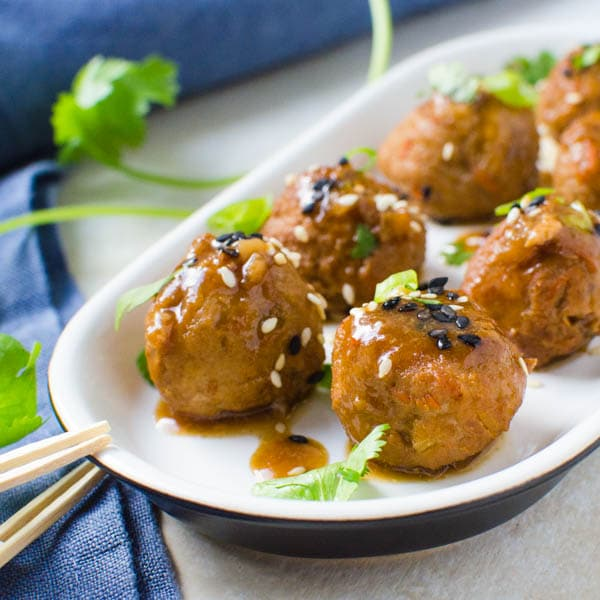 Asian Pork Meatballs with cilantro and sesame seeds.