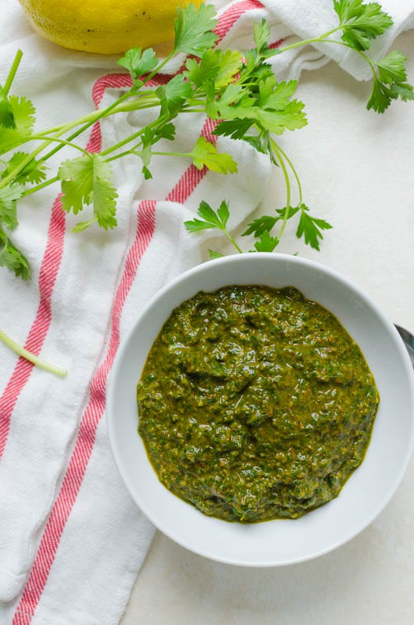 Chermoula Recipe - 2 Ways with fresh parsley and a tea towel in the shot.
