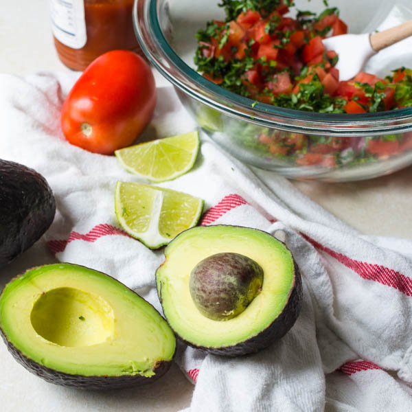 halved avocado and lime wedges.
