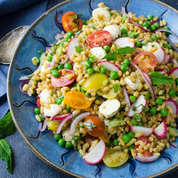 Ancient Grains Salad with a serving spoon.
