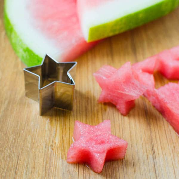 cutting watermelon into star shapes.