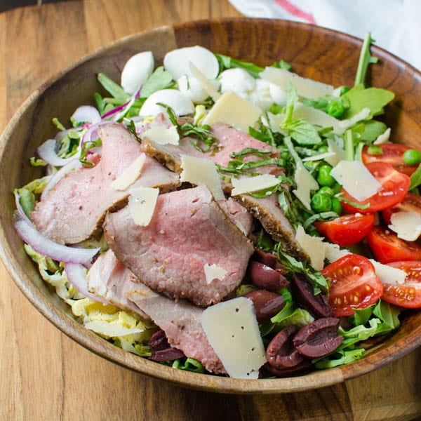 adding roast beef and cheese to the cold roast beef salad.
