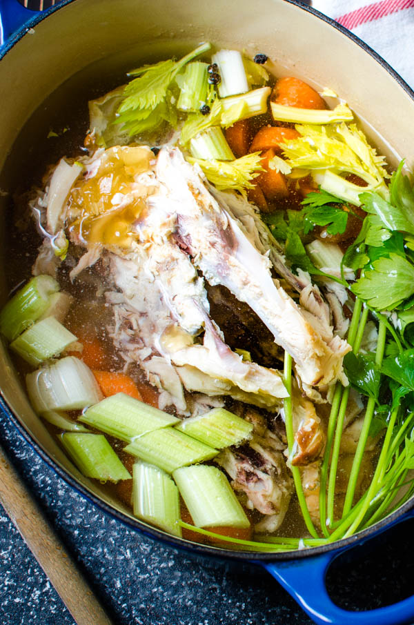 filling the pot with water to make the chicken stock.