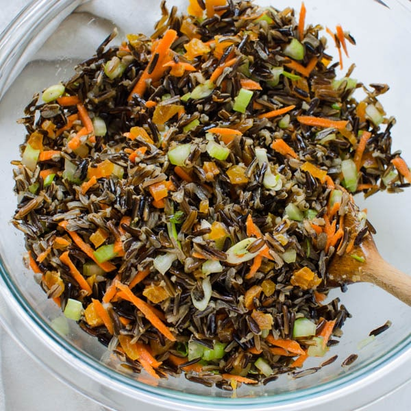 mixing wild rice with vegetables.