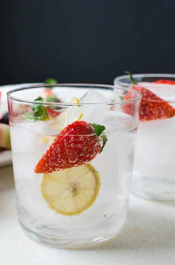 glass of fruit infused sparkling water.