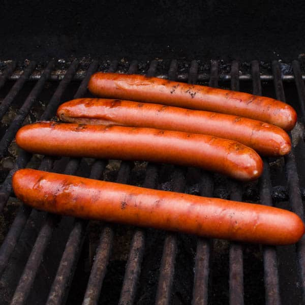 hot dogs on the grill.