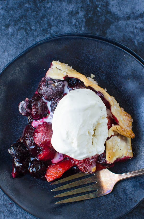 mixed berry galette with vanilla ice cream.