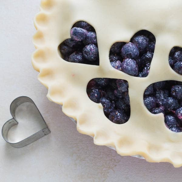 Crimping pastry edges of Homemade Blueberry Pie