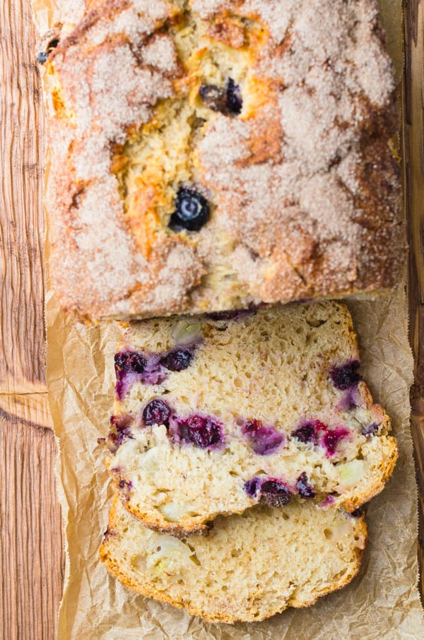 Best Blueberry Banana Bread recipe on a cutting board.