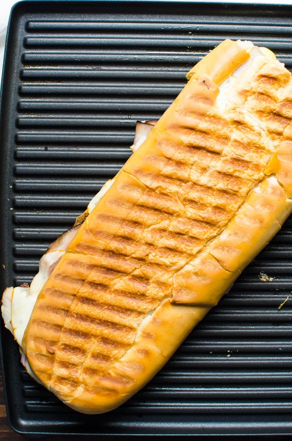 Authentic Cuban Sandwich on the griddle.