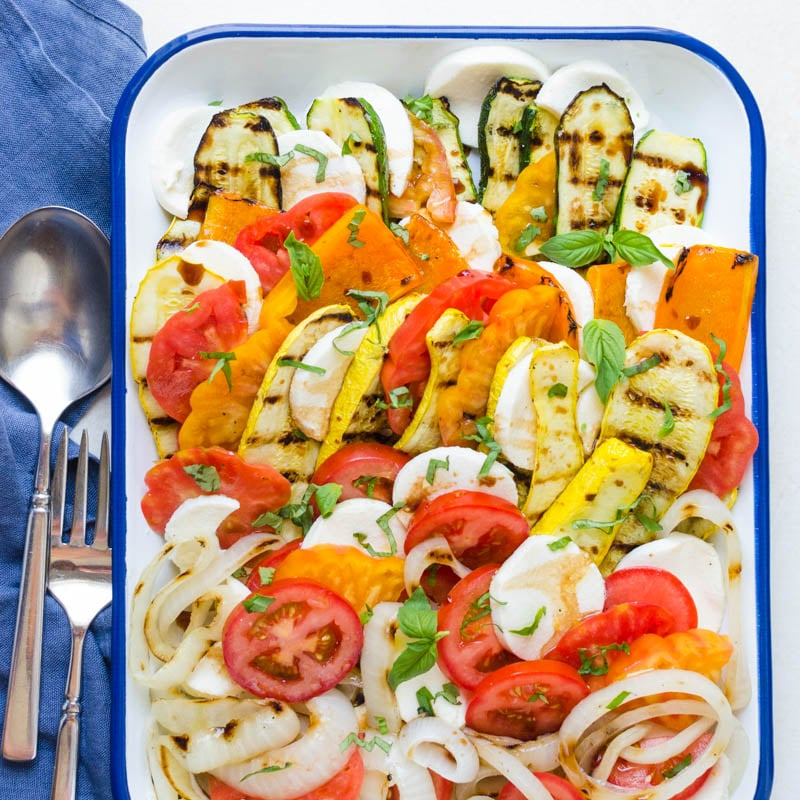 Grilled Vegetable Tomato Mozzarella Caprese with fork and spoon.