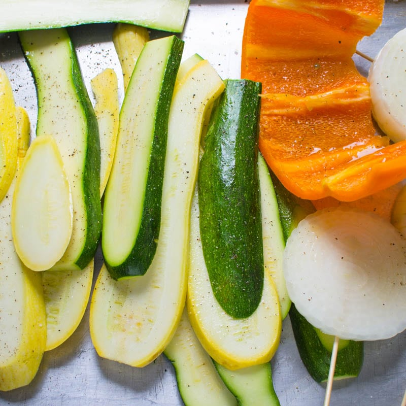 seasoning squash, onions and peppers