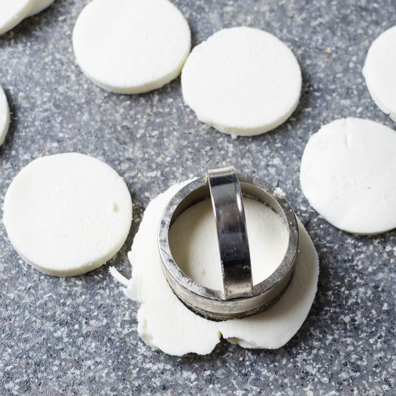 cutting mozzarella into rounds.