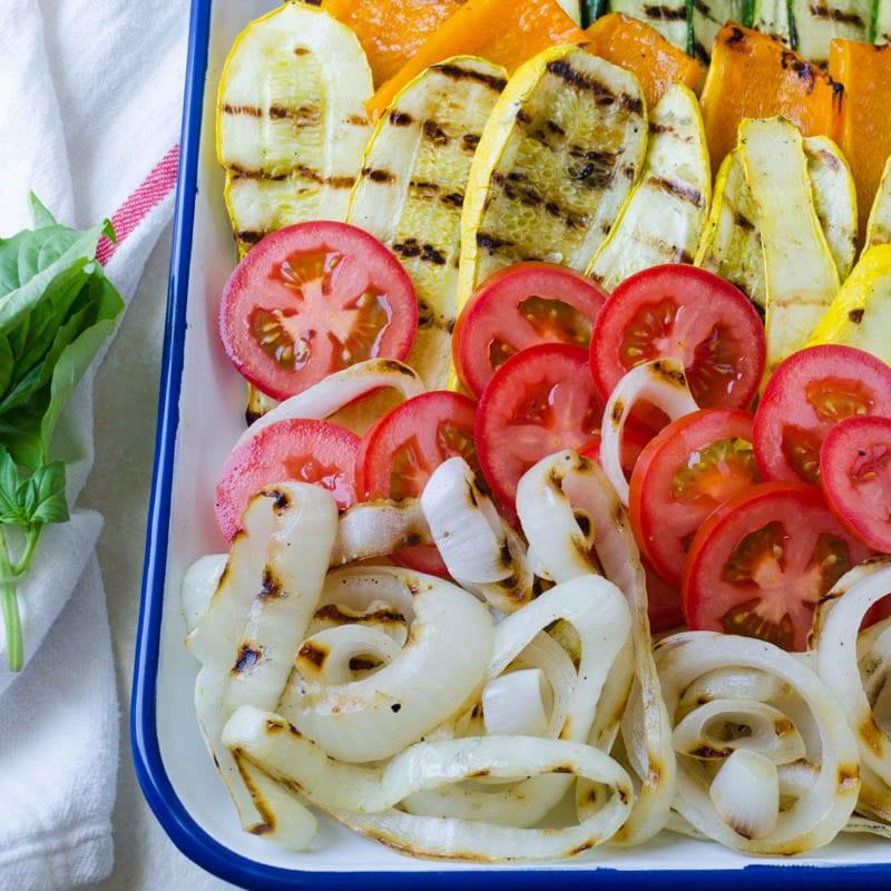 arranging vegetables on a platter.