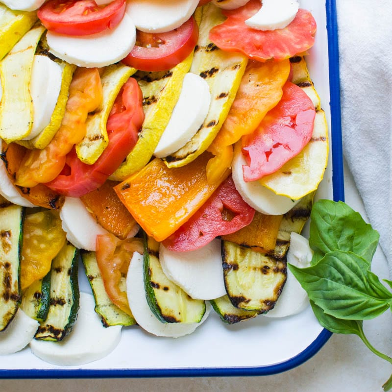 Grilled Vegetable Tomato Mozzarella Caprese on a platter.
