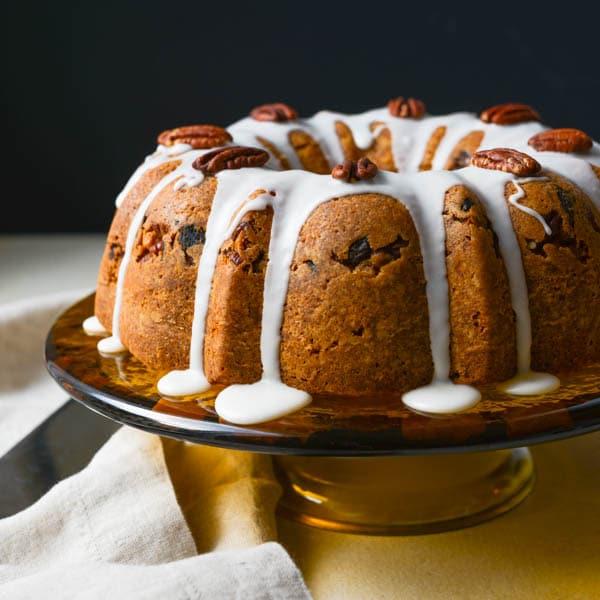 Sour cream bundt cake on a cake plate.