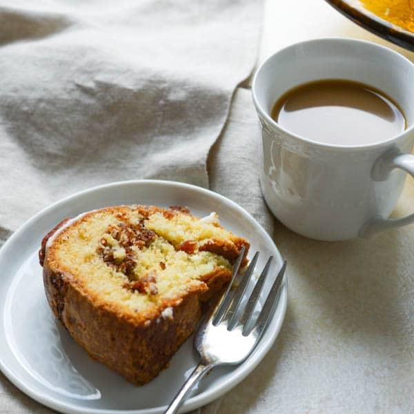 Sour cream coffee cake sliced on a plate.