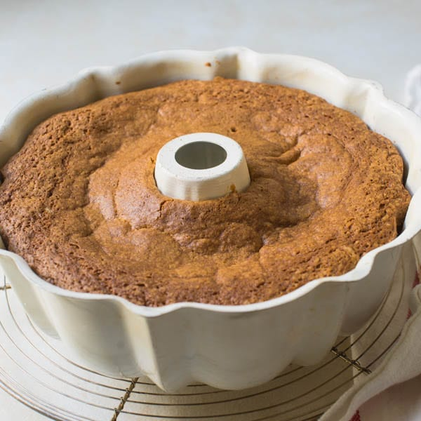 baked sour cream bundt cake cooling in the pan.
