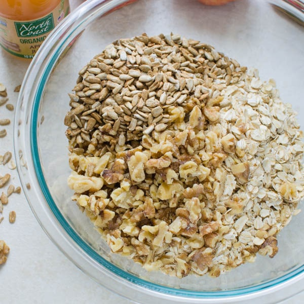 oats, walnuts and sunflower seeds in a bowl.