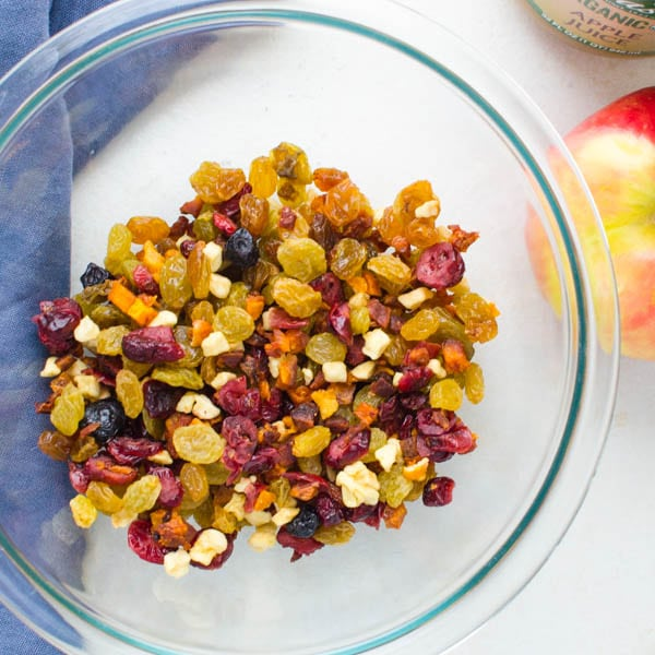 mixing up dried fruits in a bowl.