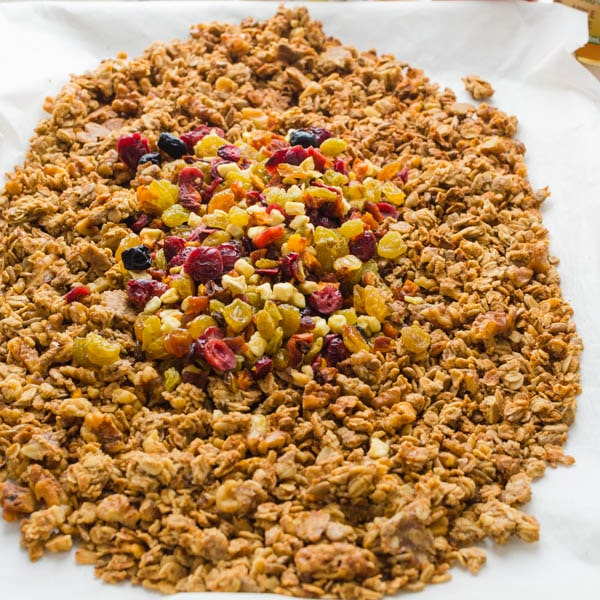 adding dried fruit to naturally sweetened crunchy granola.