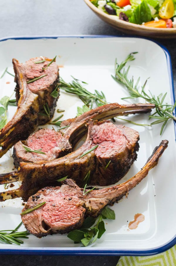 dividing herb crusted rack of lamb into lamb chops