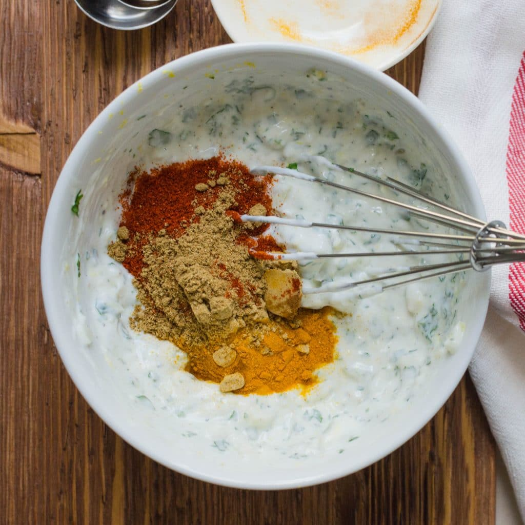 adding spice blend to tandoori marinade.