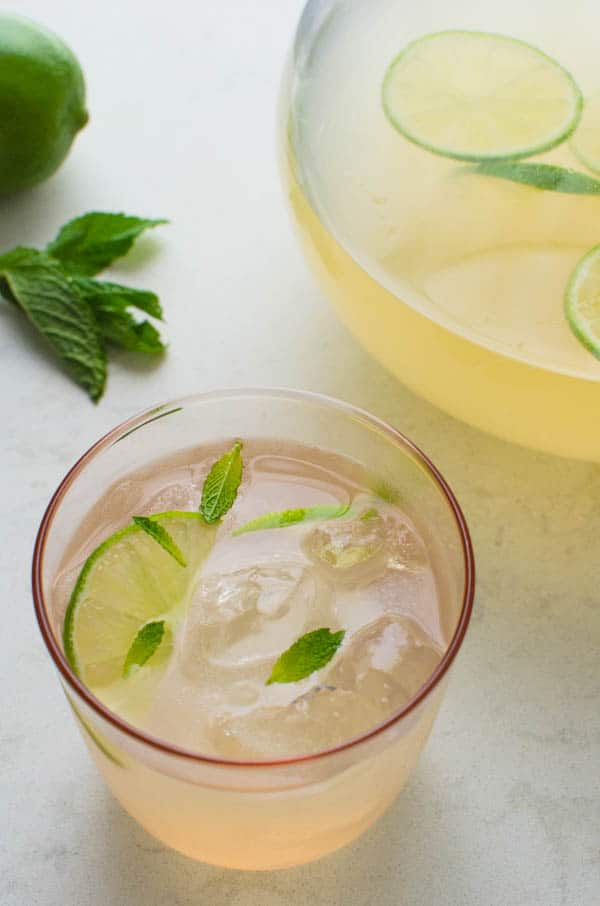 Guava Limeade Summer Mocktail with lime and mint garnish.