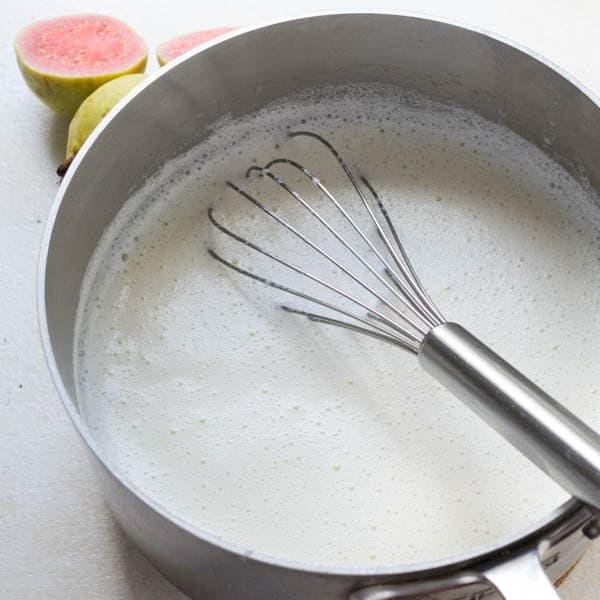 milk blend for Homemade Sherbet in a pan with a whisk.
