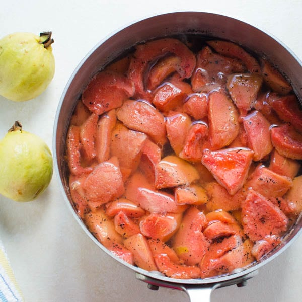 Making Guava Vanilla Simple Syrup by steeping the fruit in the syrup.